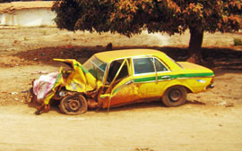 Crashed Gambian Taxi on the road to Amdallai